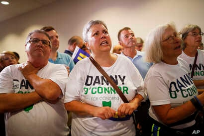 Supporters of Danny O'Connor, the Franklin County recorder, anxiously watch results during an election night watch party at the Ohio Civil Service Employees Association, Tuesday, Aug. 7, 2018, in Westerville, Ohio.
