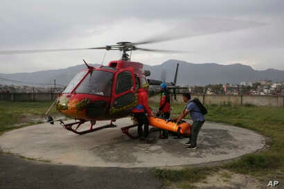 The body of famed Swiss climber Ueli Steck is unloaded from a helicopter at Teaching Hospital in Kathmandu, Nepal, April 30, 2017.