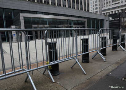 Temporary fences are placed outside the public entrance to 26 Federal Plaza, a U.S. government office building, during the partial U.S. government shutdown in New York, Jan. 8, 2019.