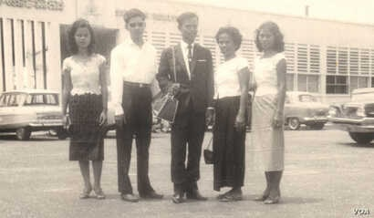 Tun Sovan, center, stands with his mother, two sisters and a brother in law. The photo was taken in front of Pochentong International Airport in 1962, before leaving to the United States. (Photo courtesy of Tun Sovan)