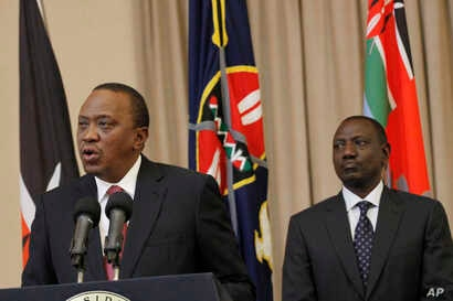 Kenya's President Uhuru Kenyatta (L) accompanied by Deputy President William Ruto, right, speaks to the media at State House in Nairobi, Kenya, Sept. 21, 2017.