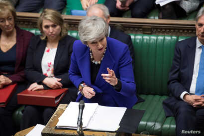 Britain's Prime Minister Theresa May speaks during PMQ session in Parliament, in London, Britain, Jan. 30, 2019.