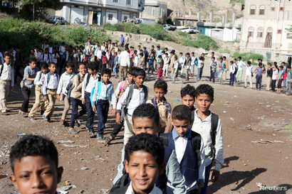 Students walk into their classes at a makeshift free school for 700 youths in Taiz, Yemen, Oct. 18, 2018.