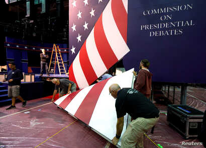 Stage hands install part of the stage for the first U.S. presidential debate at Hofstra University in Hempstead, New York, Sept. 24, 2016.