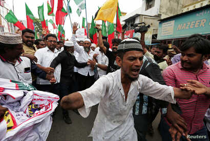 Demonstrators shout slogans during a protest against what the demonstrators say are killings of Rohingya people in Myanmar, in Chennai, India, Sept. 8, 2017.
