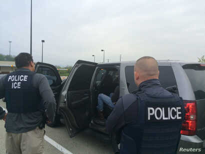 FILE - Officers from U.S. Immigration and Customs Enforcement's Enforcement and Removal Operations unit are shown during an operation targeting criminal aliens and other immigration violators in Philadelphia, in this image released May 11, 2016.