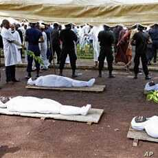 Bodies of people killed during a rally are seen at the capital's main mosque in Conakry, Guinea (Oct 2009 file photo)