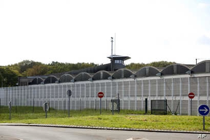 A watch tower is seen at the high-security prison of Fleury-Merogis outside Paris, Thursday, April 28, 2016. The French government estimates nearly 1,400 French prisoners are radicalized, including some 325 jailed on terrorist charges.