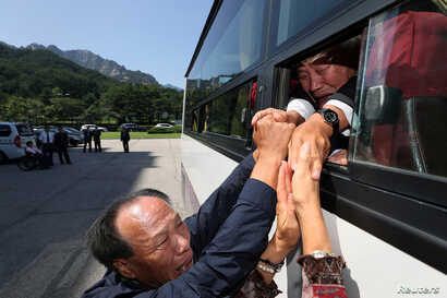 North and South Korean separated family members react as they bid farewell to each other on the last day of a reunion at Mount Kumgang resort, North Korea, August 26, 2018.
