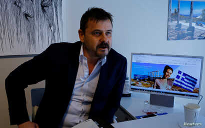 Real estate agent Cenk Tanman, speaking from his office in Istanbul, March 28, 2017, founded a website for people wanting to invest in Greece as a way to gain residency permits.