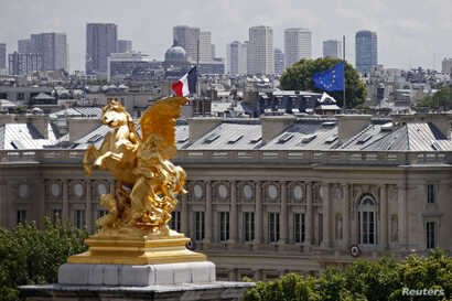 A view shows French and European flags flying half-mast at the Quai d'Orsay in Paris July 28, 2014. French President announced three days of mourning and ordered that flags on government buildings across France fly at half-mast for three days from Mo...