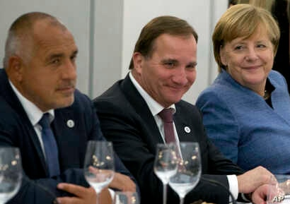 German Chancellor Angela Merkel, right, sits with Swedish Prime Minister Stefan Lofven, center, and Bulgarian Prime Minister Bokyo Borisov during an informal dinner ahead of an EU Digital Summit in Tallinn, Estonia, Sept. 28, 2017.