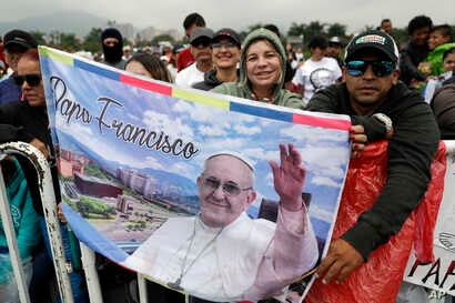 People wait for the arrival of Pope Francis to celebrate mass at the Enrique Olaya Herrera airport of Medellin, Colombia, Sept. 9, 2017.