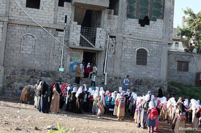 Students gather for a morning drills outside of the teacher's house, who turned it into a makeshift free school that hosts 700 students, in Taiz, Yemen October 18, 2018.