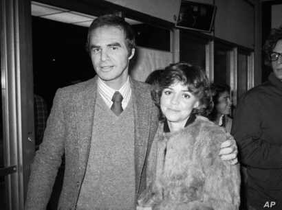"""FILE - Burt Reynolds and Sally Field attend the off-Broadway play """"Buried Child"""" in New York, Dec. 23, 1978."""