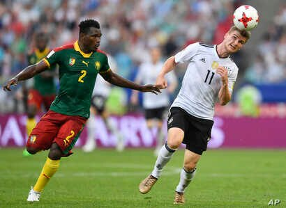 Germany's Timo Werner heads the ball past Cameroon's Ernest Mabouka during the Confederations Cup, Group B soccer match at the Fisht Stadium in Sochi, Russia, June 25, 2017.