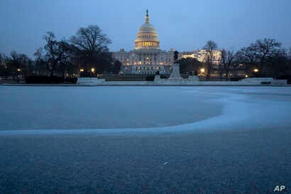 The Capitol is seen with the Reflecting Pool covered in ice and snow, in Washington, Feb. 1, 2019. U.S. lawmakers are expected to vote on a deal to provide money for border security and avert a government shutdown.