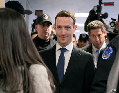 Facebook CEO Mark Zuckerberg arrives on Capitol Hill in Washington, April 9, 2018, to meet with Sen. Dianne Feinstein, D-Calif., the ranking member of the Senate Judiciary Committee.