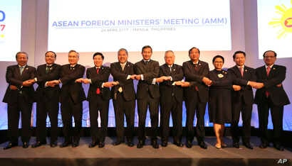 FILE - Association of Southeast Asian Nations (ASEAN) foreign ministers and Secretary-General Le Luong Minh pose for a group photo during the ASEAN Foreign Ministers Meeting (AMM) in metropolitan Manila, Philippines, April 28, 2017.