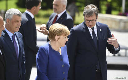Germany's Chancellor Angela Merkel, Kosovo's President Hashim Thaci and Serbian President Aleksandar Vucic pose among other heads of state during the family photo at the EU-Western Balkans Summit in Sofia, Bulgaria, May 17, 2018.