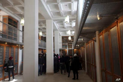 Officials walk around the main hall of the newly opened Saint Catherine library in South Sinai, Egypt, Dec. 16, 2017. The inauguration ceremony, attended by Egyptian and western officials, comes after three years of restoration work on the eastern si...