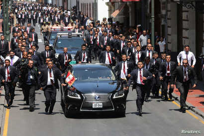 Peru's President Martin Vizcarra leaves the congress building in a motorcade, after being sworn in, Lima, Peru, March 23, 2018.