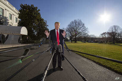 President Donald Trump speaks on the South Lawn of the White House as he walks to Marine One, Jan. 6, 2019, in Washington.