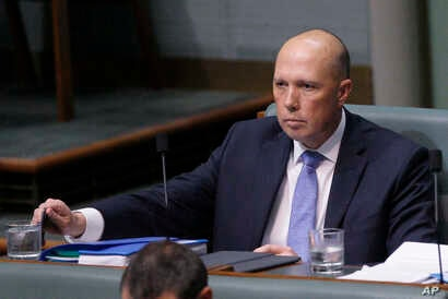 Australian former Home Affairs Minister Peter Dutton in Parliament in Canberra, Australia, Aug. 22, 2018. Dutton moved from the front row where Cabinet ministers sit to the back row after his bid to become prime minister failed Tuesday.