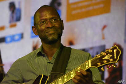 "Moustapha Diop, project developer for ""MusikBi,"" Africa's first home-grown platform for legal music downloads, speaks during a concert launch at a restaurant in Dakar, Feb. 26, 2016."