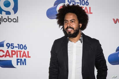 Musician Jillionaire of Major Lazer poses for photographers before performing on stage at the Capital FM Summertime Ball, in London, June 11, 2016.