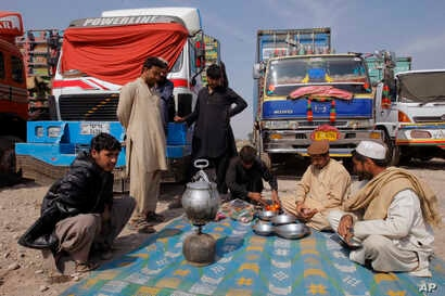 Drivers of Afghanistan-bound trucks wait for the opening of Pakistan Afghanistan border outside Peshawar, Pakistan, Tuesday, March 14, 2017. The closure of the border between Pakistan and Afghanistan, blamed on deteriorating relations, is more than i...