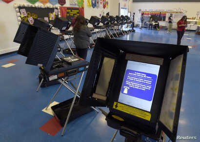 Voting machines are set up for people to cast their ballots during voting in the 2016 presidential election at Manuel J. Cortez Elementary School in Las Vegas, Nevada, Nov. 8, 2016