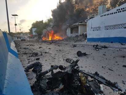 Debris litters a Mogadishu street after a car bomb exploded next to a restaurant in the Somali capital, May 24, 2017, killing eight people and injuring 15.