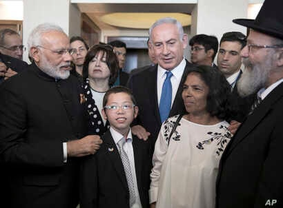 Indian Prime Minister Narendra Modi, left, with Israeli Prime Minister Benjamin Netanyahu, center right, meet with with Moshe Holtzberg, center, an Israeli boy whose parents were killed in the Nov. 26, 2008 terrorist attack on Mumbai, at the King Dav...