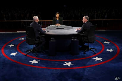Republican vice-presidential nominee Gov. Mike Pence and Democratic vice-presidential nominee Sen. Tim Kaine discuss a question during the debate.