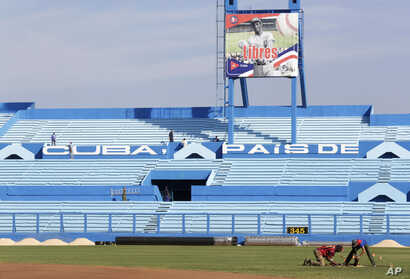 Workers are seen at the Latinoamericano baseball stadium ahead of an exhibition baseball game between the Cuban national team and U.S. team Tampa Bay Rays, in Havana, Cuba, March 16, 2016.