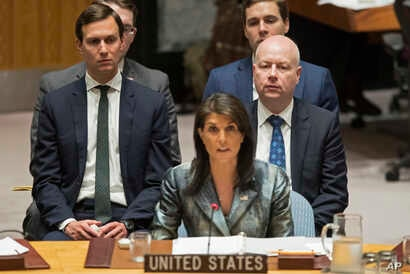 FILE -  Jared Kushner, left, and Jason Greenblatt, right, listen as American Ambassador to the United Nations Nikki Haley speaks during a Security Council meeting on the situation in Palestine at United Nations headquarters, Feb. 20, 2018.