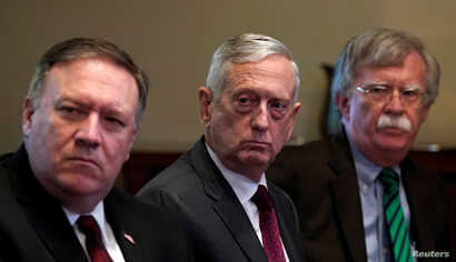 From left, U.S. Secretary of State Mike Pompeo, Secretary of Defense James Mattis and national security adviser John Bolton listen as U.S.  President Donald Trump meets with NATO Secretary General Jens Stoltenberg at the White House in Washington. U....