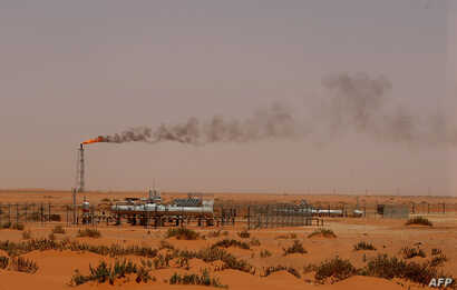 "FILE - A Saudi Aramco oil installion known as ""Pump 3"" in the desert near the oil-rich area of Khouris, 160 km east of the Saudi capital Riyadh, is seen in a June 23, 2008, photo."