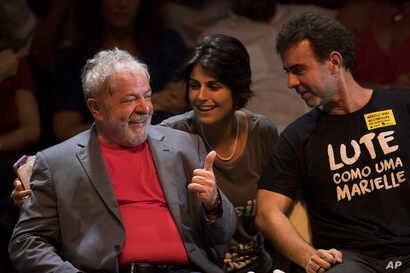 Brazil's former President Luiz Inacio Lula da Silva, left, talks to Manuela D'Avila of Brazil's Communist Party and Rio state Congressman Marcelo Freixo during his presidential campaign rally with members of his Workers Party and leaders of other lef...