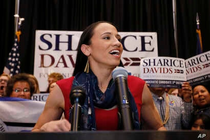 Democrat House candidate Sharice Davids speaks to supporters at a victory party in Olathe, Kan., Tuesday, Nov. 6, 2018.  (AP Photo/Colin E. Braley)