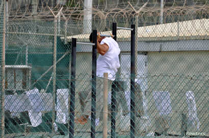 FILE - A detainee does pull-ups inside an exercise area at the U.S. detention facility at Guantanamo Bay, Cuba, April 27, 2010.