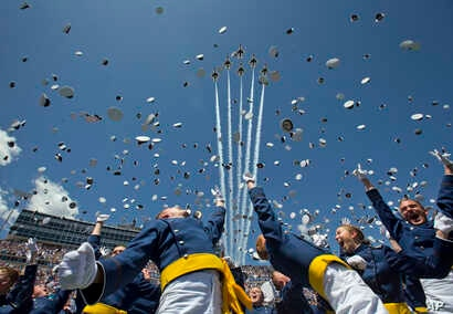 """The Air Force Thunderbirds fly overhead as graduating cadets celebrate with the """"hat toss"""" after graduation ceremonies at the 2016 class of the U.S. Air Force Academ, in Colorado Springs, Colorado, June 2, 2016."""
