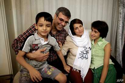 FILE - Reza Khandan, left, and his wife, Nasrin Sotoudeh, one of Iran's most prominent human rights lawyers, in Tehran, Sept. 18, 2013.. Khandan was arrested, Sept. 4, 2018, after he had publicly campaigned for the release of Sotoudeh, who had been...