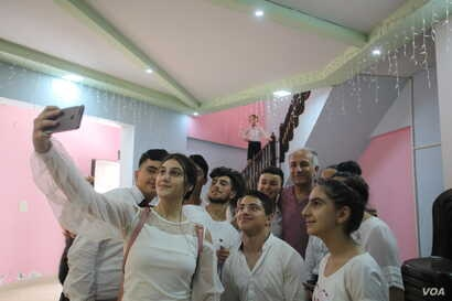 Music students in Syria's Qamishli pose for a selfie with Gani Mirzo, July 2018.