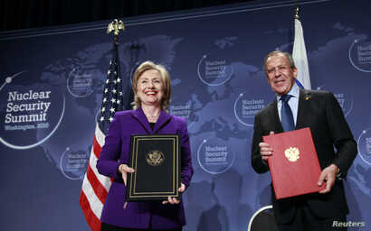 FILE - U.S. Secretary of State Hillary Clinton (L) and Russia's Foreign Minister Sergey Lavrov pose after signing the Plutonium Disposition Protocol during a ceremony at the Washington Convention Center in Washington, April 13, 2010.
