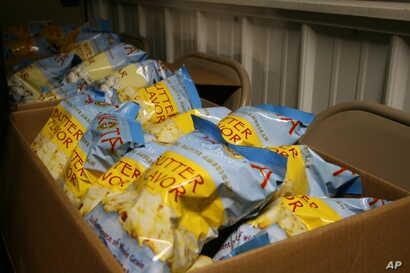 Packages of popcorn are shown in this Feb. 28, 2013, photo at Lakota Foods on the Lower Brule Indian Reservation in South Dakota.