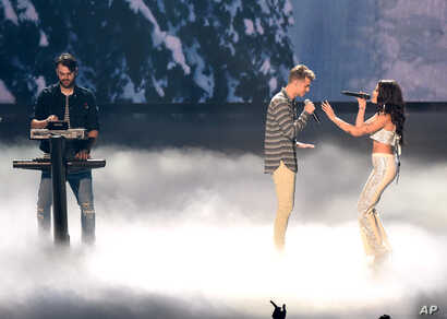 Alex Pall, left, and Andrew Taggart of The Chainsmokers, perform with Halsey at the MTV Video Music Awards at  Madison Square Garden on Aug. 28, 2016, in New York.