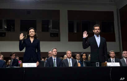 Facebook COO Sheryl Sandberg, left, accompanied by Twitter CEO Jack Dorsey are sworn in before the Senate Intelligence Committee hearing on 'Foreign Influence Operations and Their Use of Social Media Platforms' on Capitol Hill, Sept. 5, 2018, in Wash...