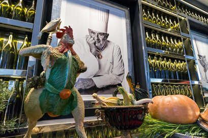 FILE - French chef Paul Bocuse's portrait is seen during a press visit for the opening of the new restaurant-school of the Institut Paul Bocuse in Lyon, Nov. 7, 2013.